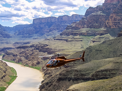 Flying in a helicopter below the canyon rim